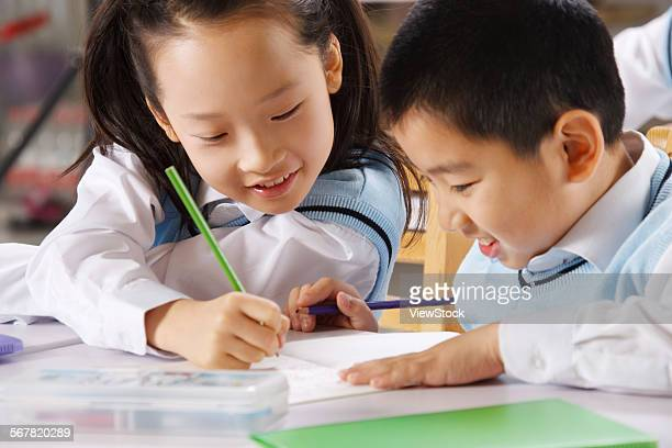 Children studying in classroom
