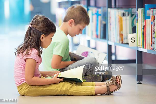Children studying in library