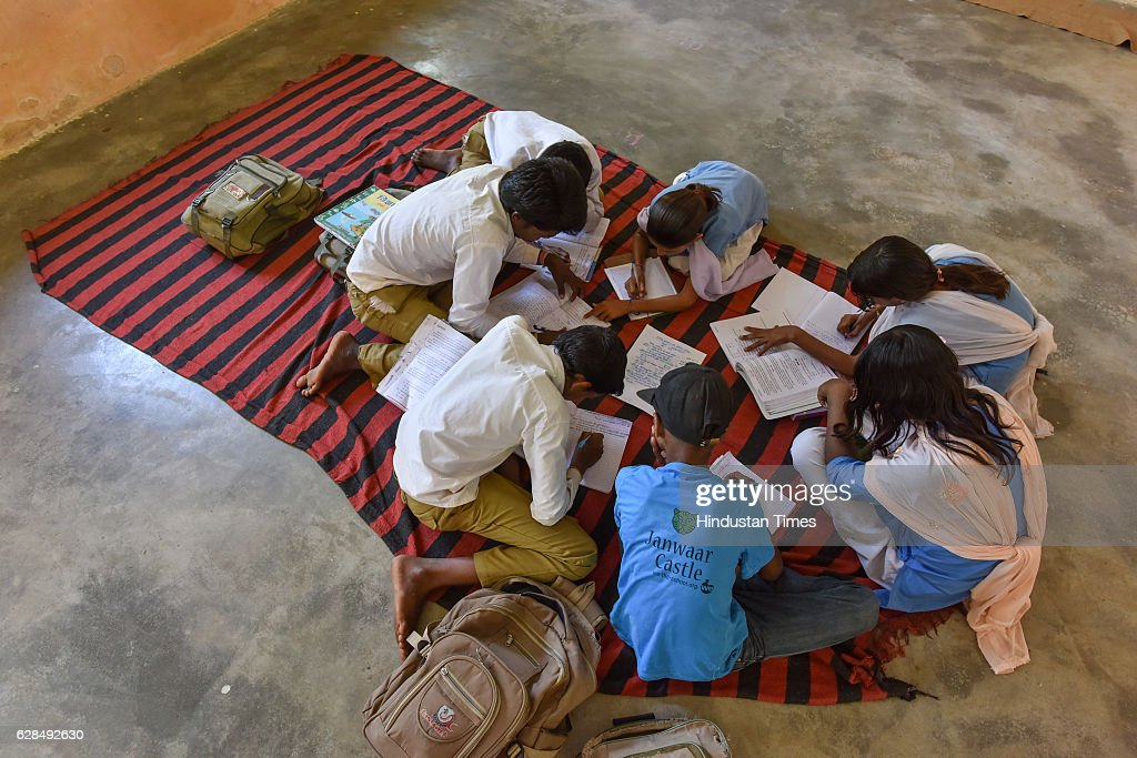 Children studying in the classroom at government school on October 26, 2016 in Janwaar, India. Thanks to a German community activist and author Ulrike Reinhard, skateboarding is slowly changing the children in this Madhya Pradesh village divided by caste. Located along the fringes of the Panna National Tiger Reserve, the Janwaar Skating Park is a not-for-profit project that teaches village children skateboarding free of cost. The park is a place for unfettered fun, but has two strict ground rules. Rule number one: Girls first. And rule number two: No school, no skateboarding. The park also bridges caste disparities by bringing together the village Adivasi and upper caste Yadav and Kushwaha children to play together.