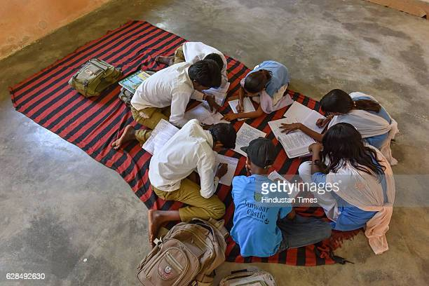 Children studying in the classroom at government school on October 26, 2016 in Janwaar, India. Thanks to a German community activist and author...