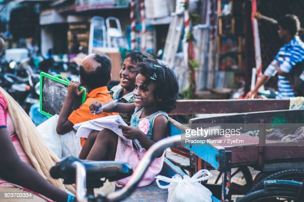 children studying on bench - tamil nadu stock pictures, royalty-free photos & images