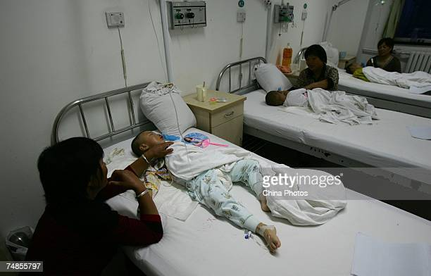 Children suffering from cleft lip and palate rest in a ward after received operations at the Xian Jingxi Hospital during registration for treatment...