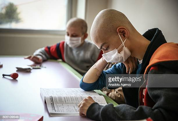 Children suffering from leucemia stuudy at a hospital school which helps children regain academic and social progress during periods of...