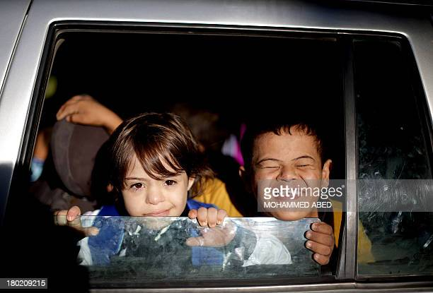 Children suffering from the Down syndrome arrive at a specialised school of the 'Right to Live Society' a Palestinian nongovernmental organisation...