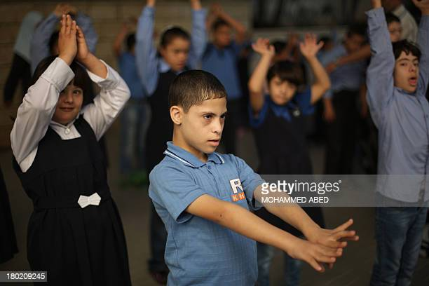 Children suffering from the Down syndrome exercise at a specialised school of the 'Right to Live Society' a Palestinian nongovernmental organisation...