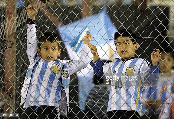 Children supporters of Argentina wait for the start of the Russia 2018 FIFA World Cup South American Qualifiers football match between Argentina and...