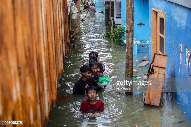 Children swim in residential areas affected by floods in Jakarta, Indonesia, on February 25, 2020.