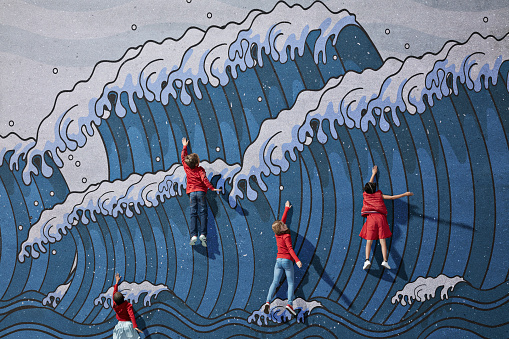 Children swimming in imaginary painted waves - gettyimageskorea