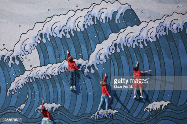 Children swimming in imaginary painted waves