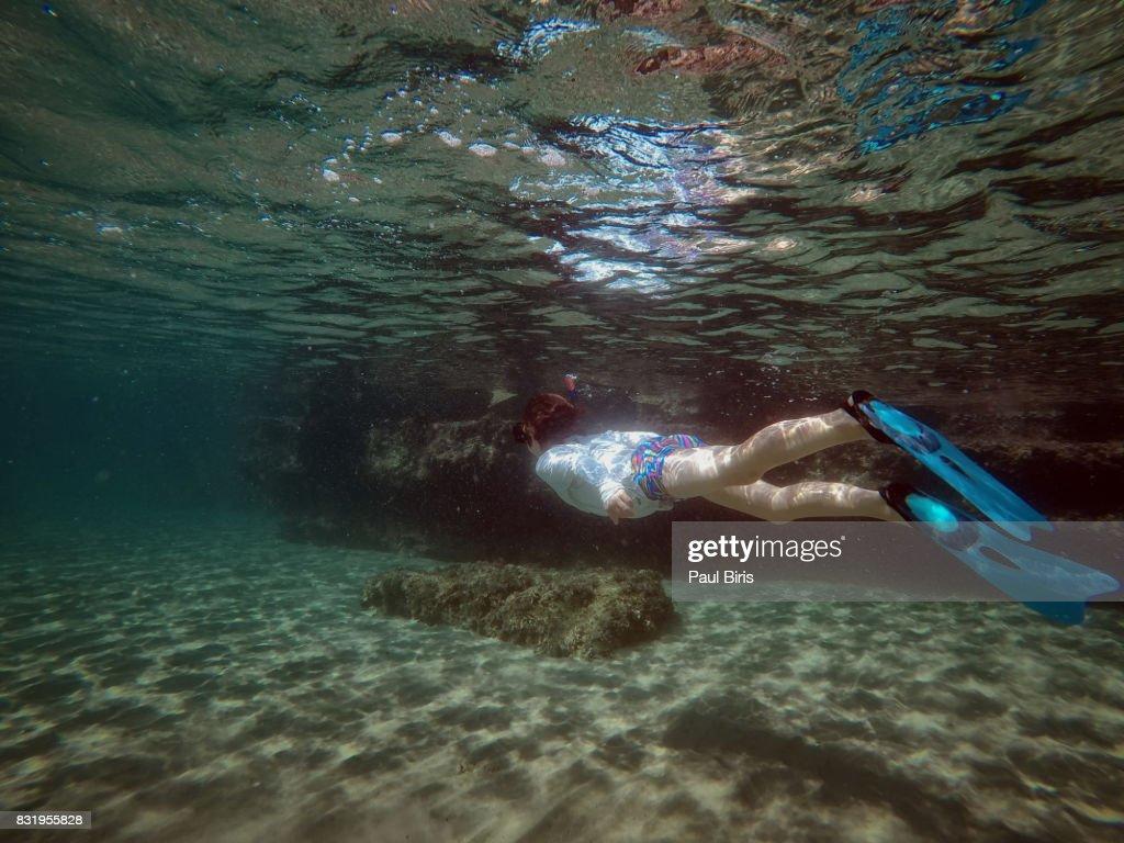 Children swimming underwater , Zakynthos Island, Greece : Stock Photo