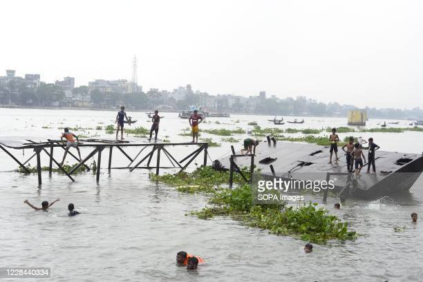 Children take a bath at the Buriganga River. Dhaka is getting back to its normal life after months of the ongoing Covid-19 pandemic.