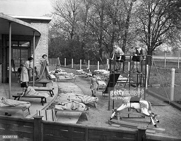 Children take a nap in the playground of the new LCC Woodberry Down Health Centre in London 15th October 1952 It is the first fully comprehensive...