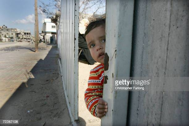 Children take advantage of election holidays to play in the bombed out ruins of Jabalia refugee camp, Gaza Strip January 11, 2005. As daily life...