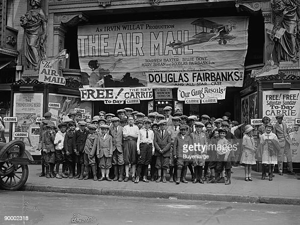 Children Take in a Theatre Presentation 'The Air Mail' Douglas Fairbanks also the presentation of 'The Little Rascals' Banner is draped across the...