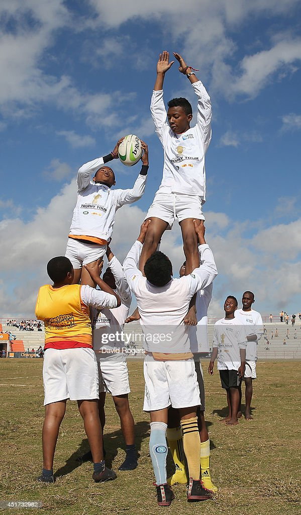 Children take in the IRB Get Into Rugby tournament during a visit to Andohatapenaka Stadium during the Rugby World Cup Trophy Tour in Madagascar in partnership with Land Rover and DHL ahead of Rugby World Cup 2015 on July 5, 2014 in Antananarivo, Madagascar.
