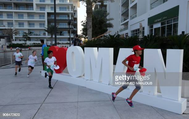 Children take part in a children's race on the sidelines of the Muscat Marathon 2018 in the Omani capital on January 18 2018 / AFP PHOTO / MOHAMMED...