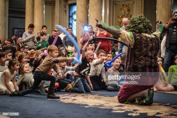 Children take part in a Christmas ceremony at the Palace of the National Military Club in Bucharest on December 21 2017 Children of the Romanian Army...
