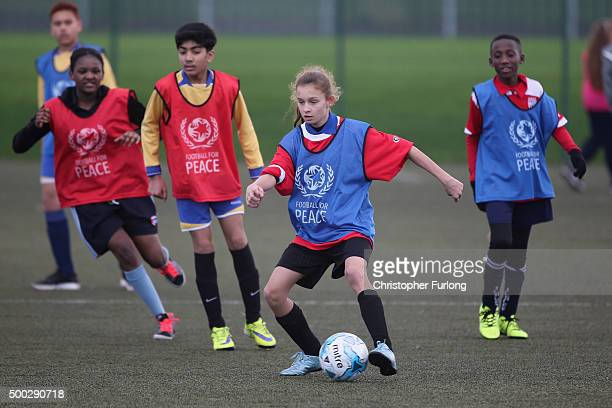 Children take part in a football game as Prince William, The Duke of Cambridge, visits Saltley Academy and the Football for Peace project on December...
