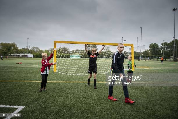 Children take part in a football training at the FC Groningen club in Groningen, on April 29, 2020 as the measures adopted by the Dutch government to...