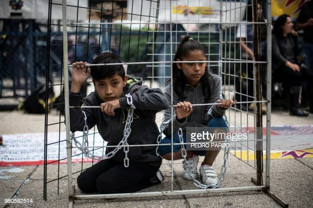 TOPSHOT Children take part in a protest against US immigration policies outside the US embassy in Mexico City on June 21 2018 US lawmakers were...