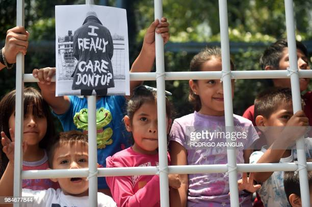 Children take part in a protest against US immigration policies outside the US embassy in Mexico City on June 26, 2018. - Three undocumented migrant...