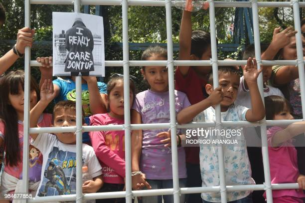 Children take part in a protest against US immigration policies outside the US embassy in Mexico City on June 26 2018 Three undocumented migrant...