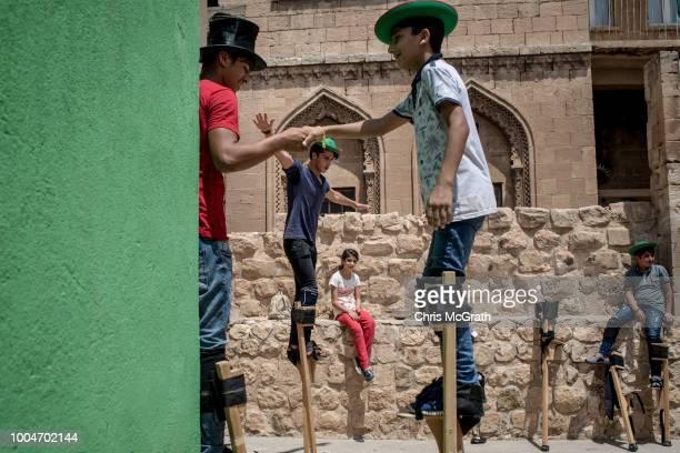 Children take part in a stilt workshop at the Mardin Sirkhane Center on July 23 2018 in Mardin Turkey The circus school or Her Yerde Sanat translated...