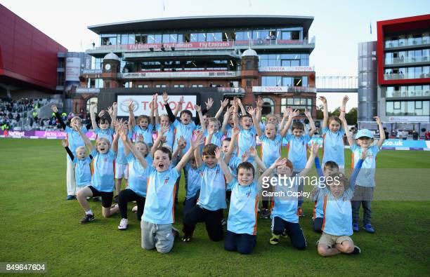 Children take part in All Stars Cricket during the 1st Royal London One Day International match between England and the West Indies at Old Trafford...
