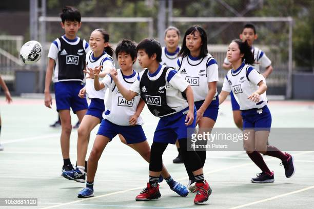 Children take part in an All Blacks coaching clinic during a New Zealand All Blacks visit to the Shiba Elementary School on October 26 2018 in Tokyo...