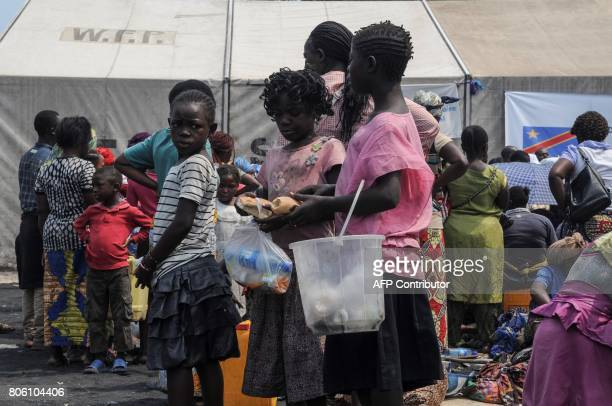 Children take part in an evacuation exercise triggered by a simulated volcanic eruption endangering Goma in Goma on July 3 2017 More than a thousand...