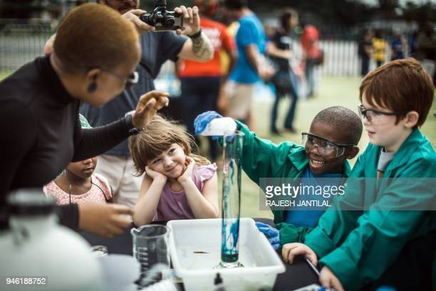 Children take part in an experiment called 'Elephant Lips' during the March for Science in Durban on April 14 2018 Organised by by the University of...