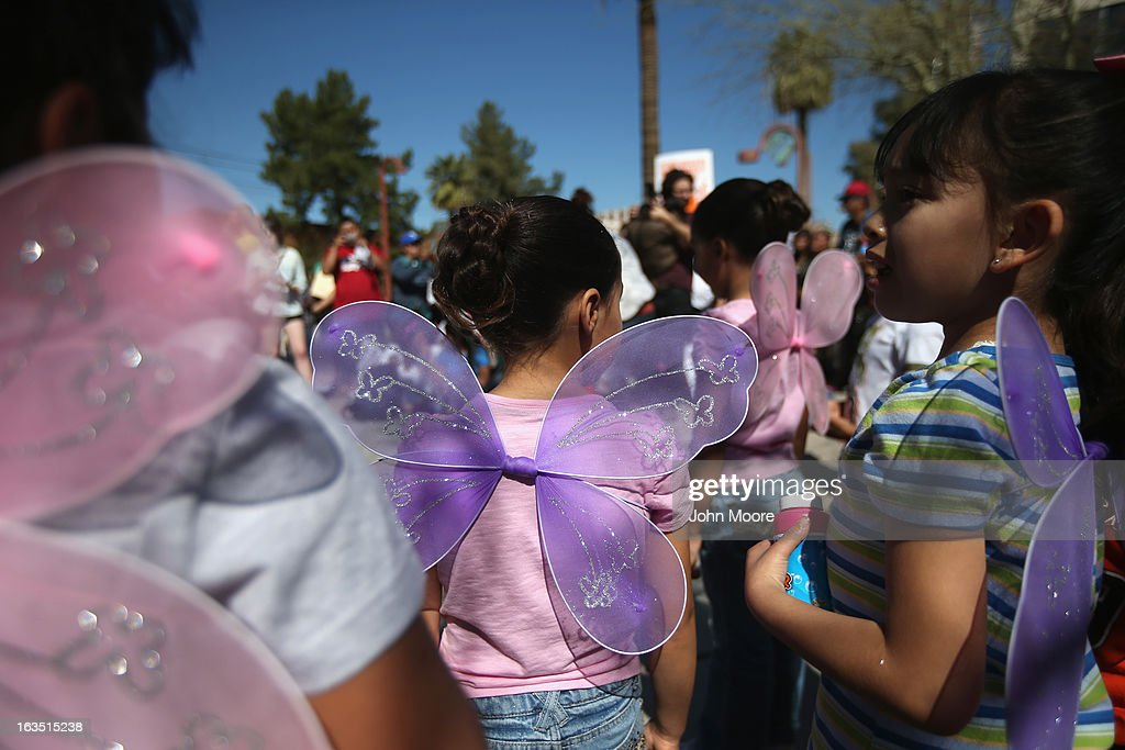 Children take part in an immigration reform demonstration outside the U.S. Immigration and Customs Enforcement (ICE), office on March 11, 2013 in Phoenix, Arizona. The march called for an end to ICE deportation, family separation and workplace raids on immigrants.