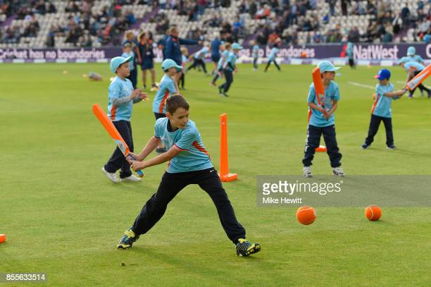 Children take part in the All Star cricket project during the interval break of the 5th Royal London One Day International between England and West...