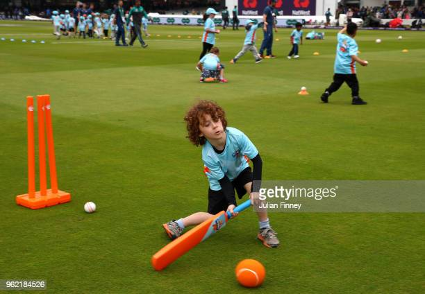 Children take part in the All Stars cricket at the interval during day one of the 1st Test between England and Pakistan at Lord's Cricket Ground on...