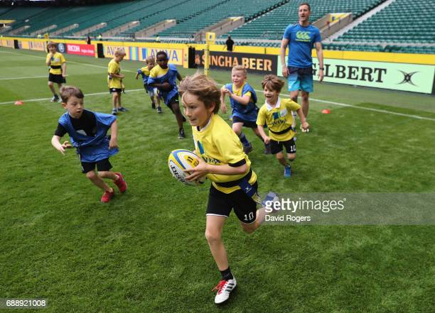 Children take part in the Aviva Rugby Clinic with Will Greenwood prior to the Aviva Premiership match between Wasps and Exeter Chiefs at Twickenham...