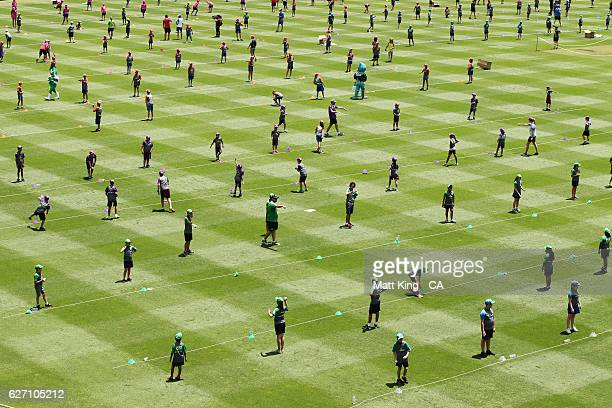Children take part in the Junior Guiness World Record Attempt for the largest Cricket Lesson at Sydney Cricket Ground on December 2 2016 in Sydney...