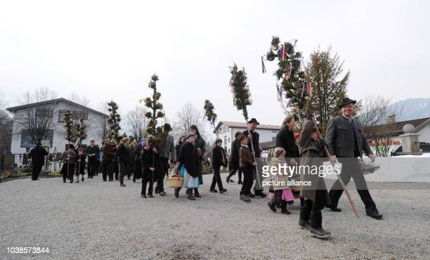 Children take part in the Palm Sunday procession in Rottach-Egern, southern Germany, 24 March 2013. Palm processions, at the beginning of Holy Week,...