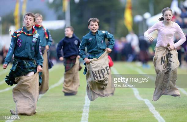 Children take part in the sack race at the annual Braemer Highland Games at The Princess Royal and Duke of Fife Memorial Park on September 7 2013 in...