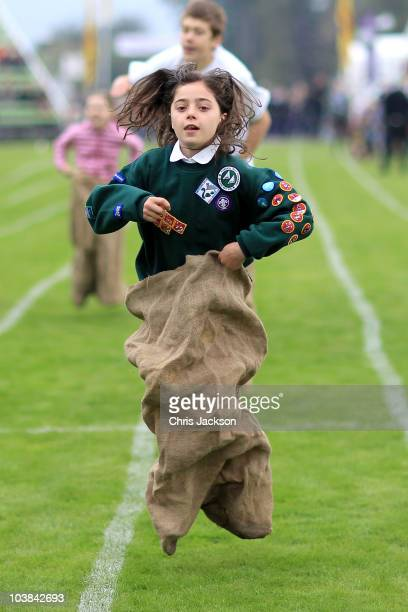 Children take part in the sack race during the Braemar Highland Games at The Princess Royal and Duke of Fife Memorial Park on September 4 2010 in...