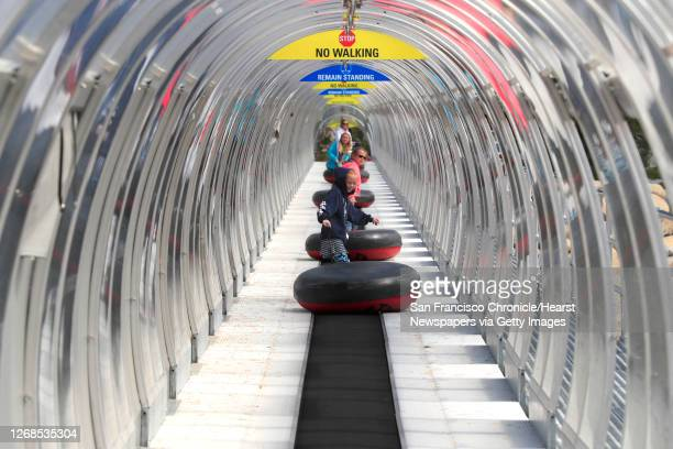 Children take the ramp up to the top for some tubing which takes place inn the summer or winter, one of a number of activities at the top of the...