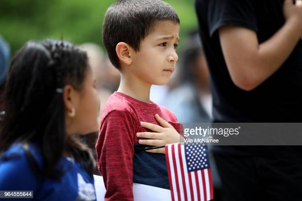 Children take the say the Pledge of Allegiance during a children's citizenship ceremony hosted by US Citizenship and Immigration Services May 31 2018...