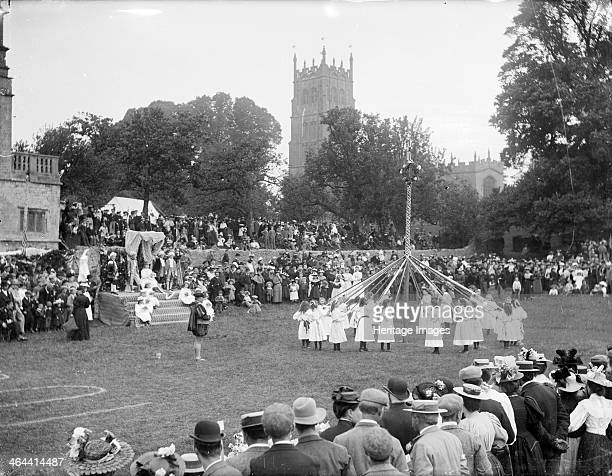 Children taking part in the village maypole dance at Chipping Campden, Gloucestershire, c1900. The tower of St James's church is in the background.
