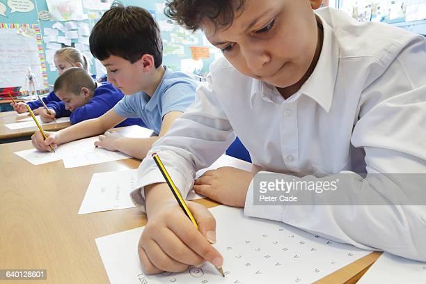 Children taking test in classroom