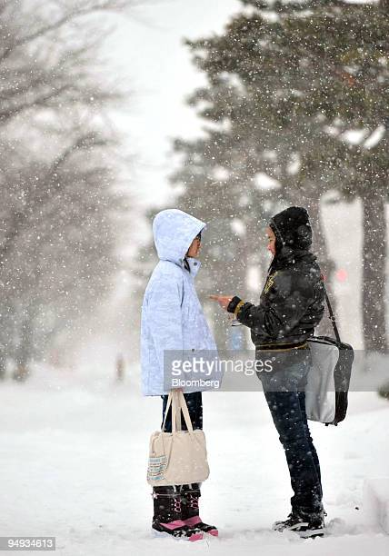Children talk each other during a snow storm in Towada City Aomori Prefecture north of Honshu Japan on Friday Dec 26 2008 Japan Airlines Corp and All...