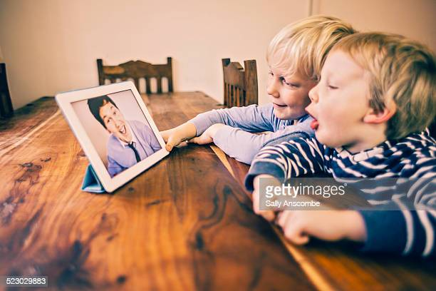 Children talking to their Daddy over the internet
