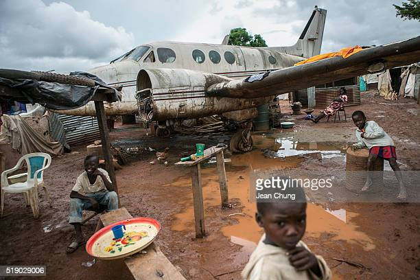 Children tend food stalls around a disposed airplane inside M'poko IDP camp near Bangui Airport on November 6, 2015 in Bangui, Central African...