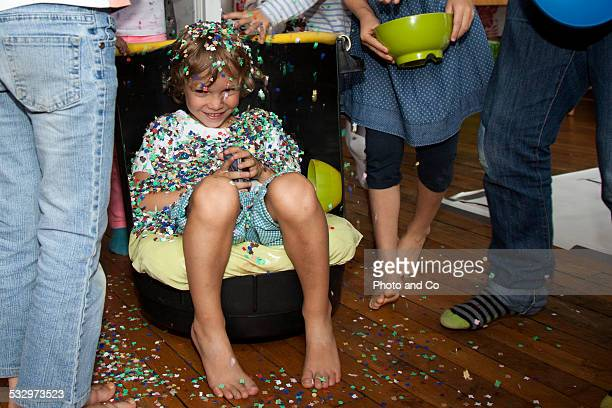 children throwing confetti