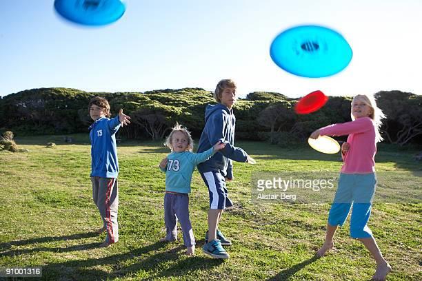 Children throwing frisbees