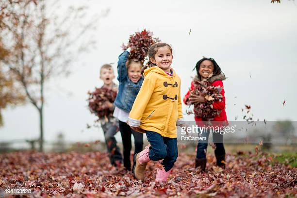 Children Throwing Piles of Leaves at Each Other