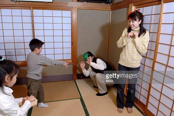 Children throwing roasted beans for setsubun festival